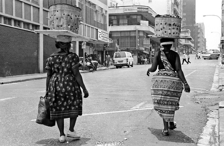 Showing remarkable balancing skills, these two ladies were photographed taking a walk in Hillborough. This picture speaks a thousand words. [Source: http://otmardreselimages.photoshelter.com] #pinyourcity