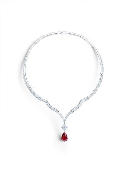 Piaget's High Jewelry Collection: Ruby Necklace. 18k white gold set with a pear shaped ruby, a princess-cut diamond and 143 brilliant cut diamonds