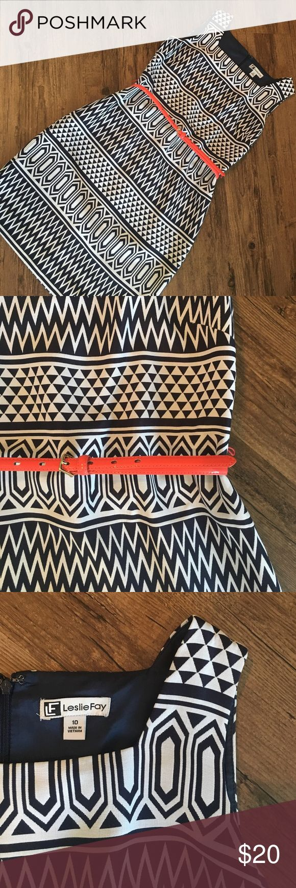 Chevron Print Dress This navy and white dress is so flattering on! Comes with neon coral belt, and there are string loops to keep belt in place. This dress has been loved 💕 Leslie Fay Dresses