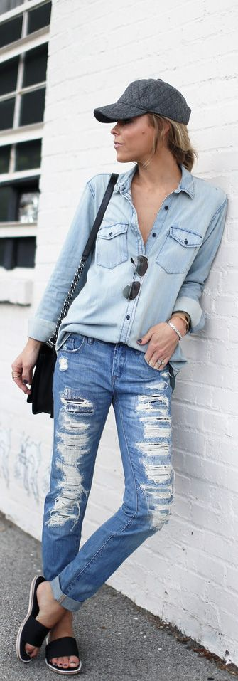 Mary Seng is wearing a denim shirt from Gap, ripped jeans from Blank NYC, flats from Whistles, bag from Chanel and the hat is from Madewell