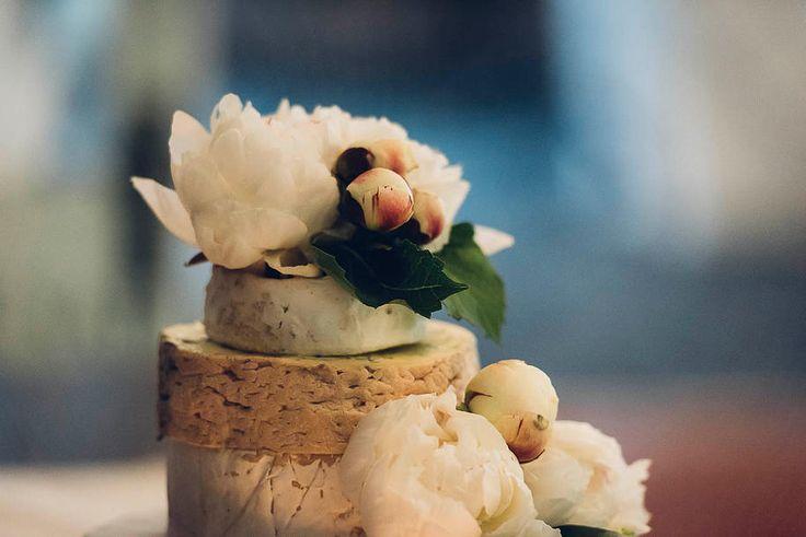 """The """"cheese cake"""" with beautiful white flowers - so simple yet stunning. #ivyandmoss #weddingcake #weddingcheese #cheesecake #cake #classicwedding #flowers #white"""
