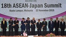 (L-R) Philippine President Benigno Aquino, Singapore's Permanent Secretary for Foreign Affiars Chee Wee Kiong, Thailand's Prime Minister Prayut Chan-O-Cha, Vietnam's Prime Minister Nguyen Tan Dung, Japanese Prime Minister Shinzo Abe, Malaysia's Prime Minister Najib Razak, Laos Prime Minister Thongsing Thammavong, Brunei Sultan Hassanal Bolkiah, Cambodia's Prime Minister Hun Sen, Indonesia's President Joko Widodo and Myanmar President Thein Sein pose for photographers during the 18th…