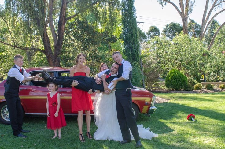 Candid Photos of a Lifetime - If you're going to hold the groom up, why not use the little flowergirls head to rest his legs on...  www.candidphotosofalifetime.com.au