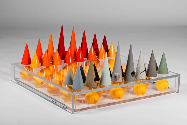 XYZ Integrated Architecture have created a collection of chess sets with conical men that can be set on the floor, on the table, or played vertically.