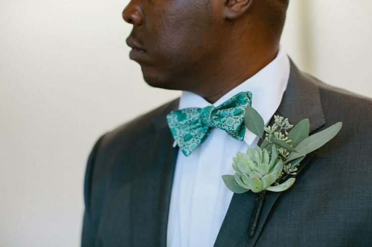 Paul's boutonniere features curly willow, succulents, and seeded eucalyptus: