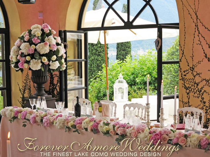 Villa Balbianello wedding reception, Loggia Segrè. Imperial top table, arrangements in white, ivory and pale peach shades, mercury glass exclusive items. Picture by ForeverAmoreWeddings ©