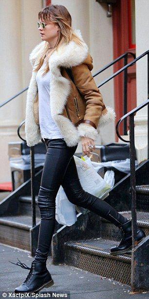 Chills and thrills: She paired her  trousers with a warm sheepskin jacket on a cold day in...