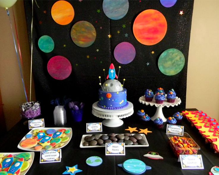 Space themed party table and cake