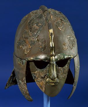 "Helmet from Sutton Hoo, Suffolk. The hero Beowulf is never described in physical detail and remains fairly inscrutable. Since 1939, though, when the treasures buried at Sutton Hoo were unearthed, many people have been tempted to associate the poem with objects found at that site. This helmet, for some present-day readers, may be as close to the man ""Beowulf"" as one can get. (Copyright: Trustees of the British Museum, London)"