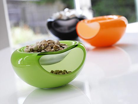 Brilliant!! Bowl that holds both your nuts and it's shells.