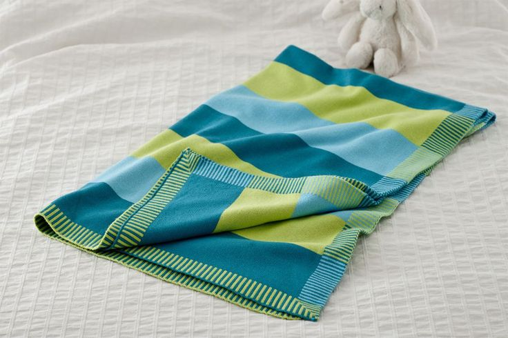 Moka Baby Blanket  Moka is our charming striped blue and green baby blanket, with a touch of teal, perfect to wrap around your little boy or girl. This 100% organic cotton reversible blanket is super soft and ideal for prams, cots, playtime and car journeys. Our beautiful baby blankets are lovingly wrapped in contemporary kiki moon boxes, the perfect gift for loved ones or for yourself.  Size; 80cm x 100cm  #babyblanket #irishdesign #irish #babygifts