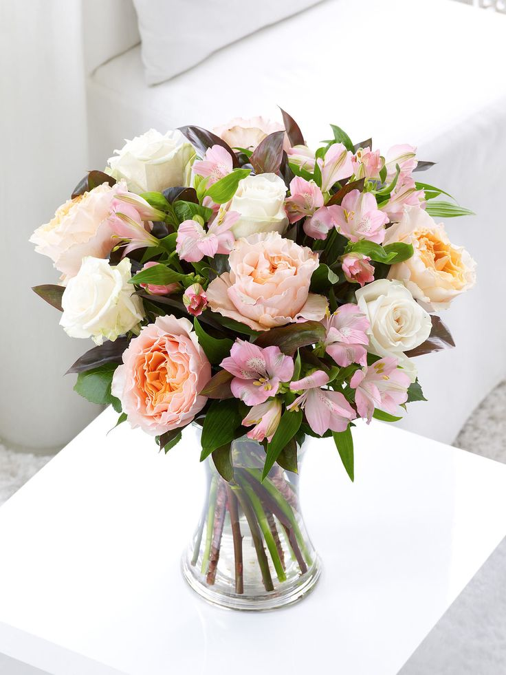 Fairtrade Vintage Rose and Alstroemeria Hand-tied - Interflora Featuring 5 peach/pink roses, 3 cream/white roses and 3 light pink alstroemeria hand-tied with dracaena.