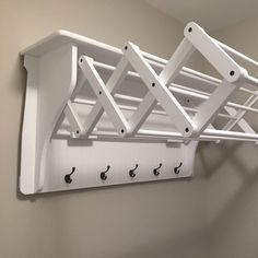 Remove current open shelves and install these as drying rack in laundry room-Extends out to provide 10 drying racks. -Collapses completely to an attaractive display shelf with 5 large hanging hooks. -Water res