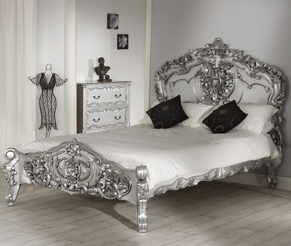 Bold glam bed. Love the black accents on the silver furniture and background.