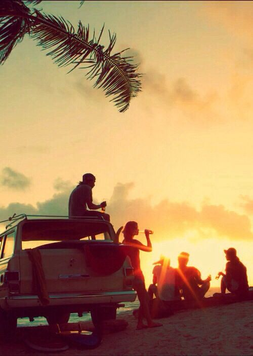 Watching the sunset on the beach, with good friends and good feelings