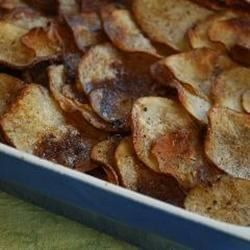 Very simple lamb and potato casserole made with layers of sliced potatoes, browned onion and leg of lamb, fresh thyme, stock and seasoning.