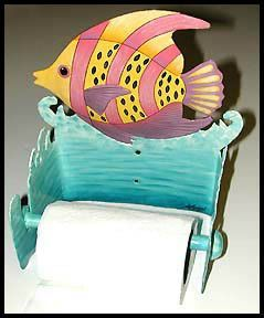 This hand painted metal toilet paper holder can also be used as a guest towel holder.