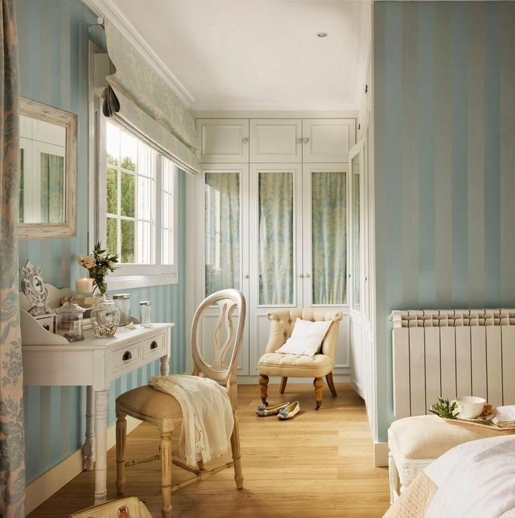 a cool blue dressing room with stripe wallpaper idea and rustic wooden dressing…