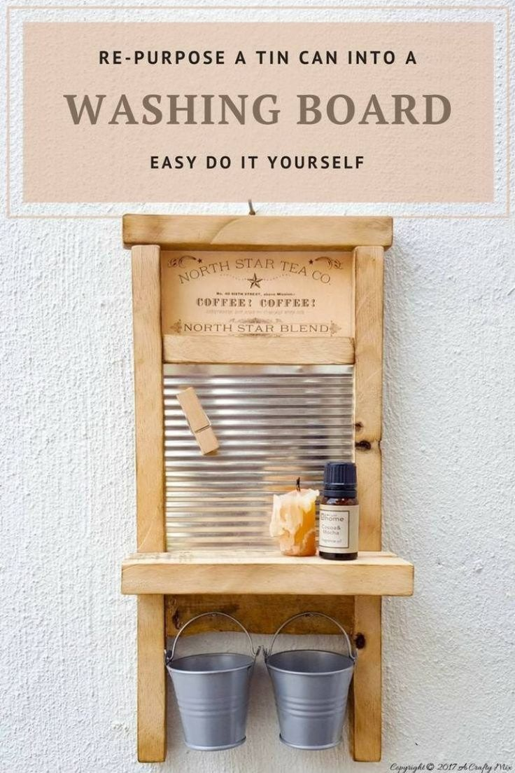 Isn't this antique washboard just too adorable. It's made from a tin can and scraps of wood.