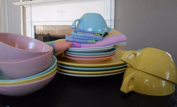 Mid-century Melmac plastic dinnerware in beautiful pastel colors. Very good condition. The plates have some fork and knife scratches but the still have very solid color. Set includes: 4 - 10 plates 6 - cups, 2 pink, 2 yellow, 2 turquoise 5 - saucers, 2 pink, 1 turquoise, 2 white