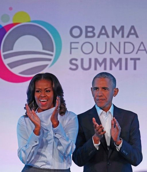 Michelle Obama Photos - Former US President Barack Obama and his wife Michelle arrive at the Obama Foundation Summit in Chicago, Illinois, October 31, 2017. / AFP PHOTO / Jim Young - Michelle Obama Photos - 26 of 9409
