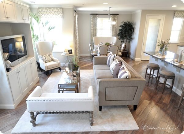 Neutral Living Room - floors! nailhead! tv cabinet! love! - model townhouse tours via Centsational Girl blog