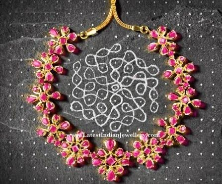 Tanishq launched its new range of collection inspired by kolam/muggu/rangoli that is closely associated with Indian woman. The traditional art of joining the dots to form beautiful symmetric shapes, takes a new form of jewelry, with vibrant rubies.
