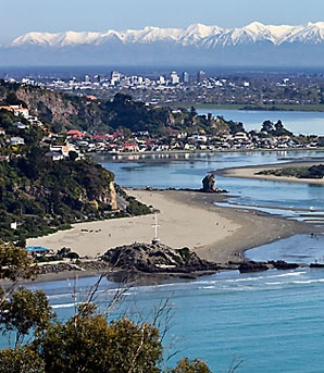 Sumner and Scarborough beach in Christchurch, New Zealand -Cross (foreground), 'Shag Pile' (middleground)