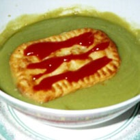 A pie floater is a meat pie that is served with tomato sauce. It is always placed in thick green pea soup. The National Trust of Australia gave the pie floater the status of a South Australian Heritage icon in the year 2003. # food