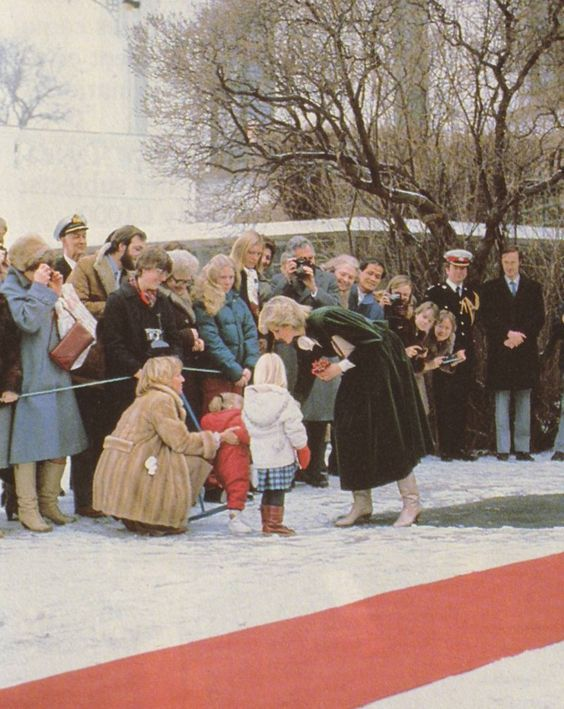 February 12th/1984~ Princess Diana receives a posy from a child at the British Embassy during her visit to Oslo, Norway.