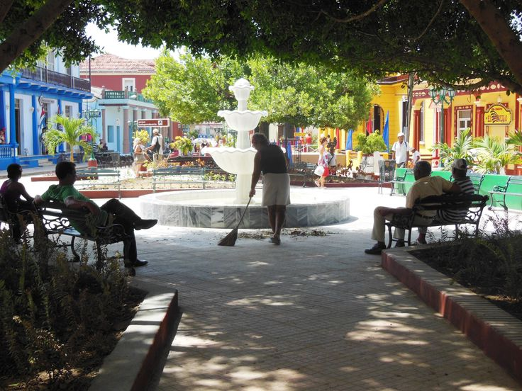 """""""Sweeping the Square,"""" Baracoa (photo by Kathryn MacDonald© at www.travelnotebook.ca)"""