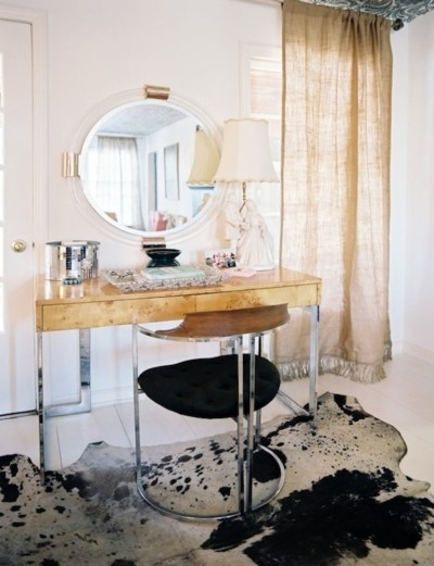 cowhide under vanity.....time to remove my bedroom carpet. I want my hides in my room!!