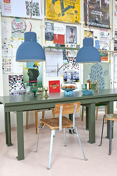 Love the wall ☆ Blue lampshades, green table, vintage chairs