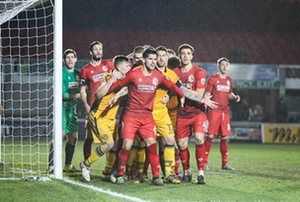Alfreton Town defend a Newport County corner in their FA Cup first round replay at Rodney Parade, Newport.
