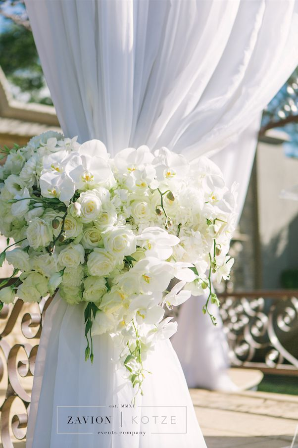 Floral Tie back, draping, ceremony, wedding ceremony. Bridal Table - White wedding flowers in huge arrangements, crisp white and green wedding. Banquet tables with floral runners, elegant wedding. Luxury wedding.