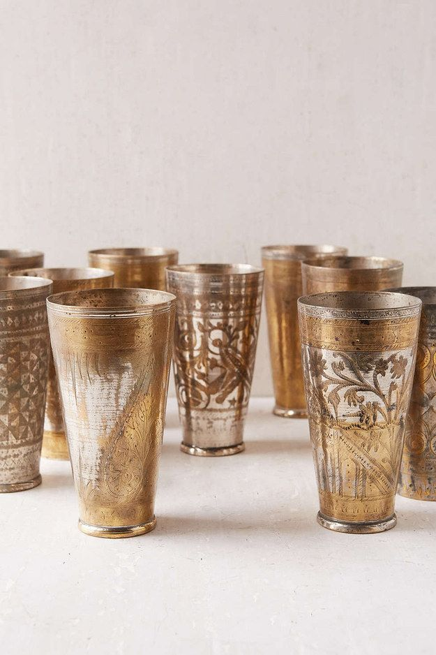 Opulent brass cups that are worthy of any king or queen.