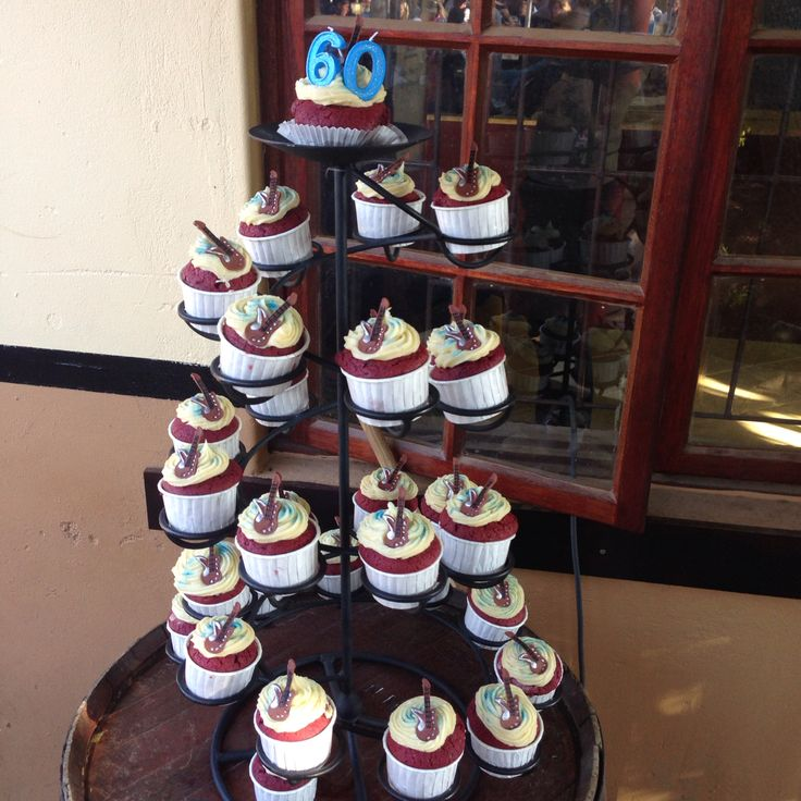 60th birthday cupcake tower. Cupcakes with edible guitar toppers