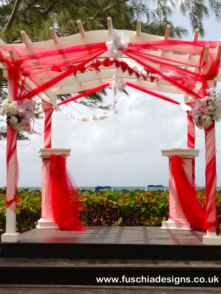 Preparation for a wedding at the Turtle Beach Resort in Barbados.  The decoration was themed to the couples choice.  By www.fuschiadesigns.co.uk.