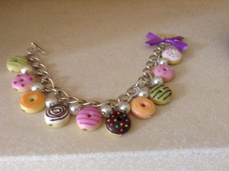 A personal favourite from my Etsy shop https://www.etsy.com/uk/listing/542481400/sliver-bracelet-with-decoden-doughnuts