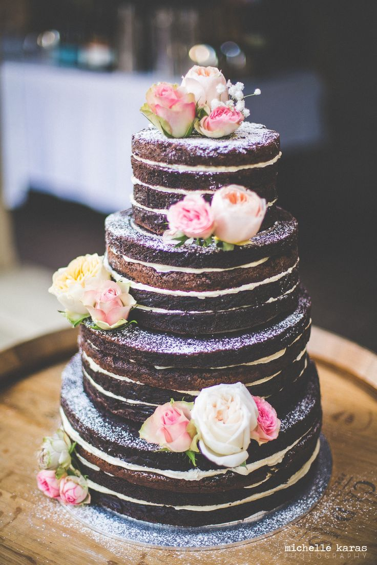 4 tiered dark chocolate brownie naked cake filled with vanilla bean buttercream - also cake with different tiers as different flavors