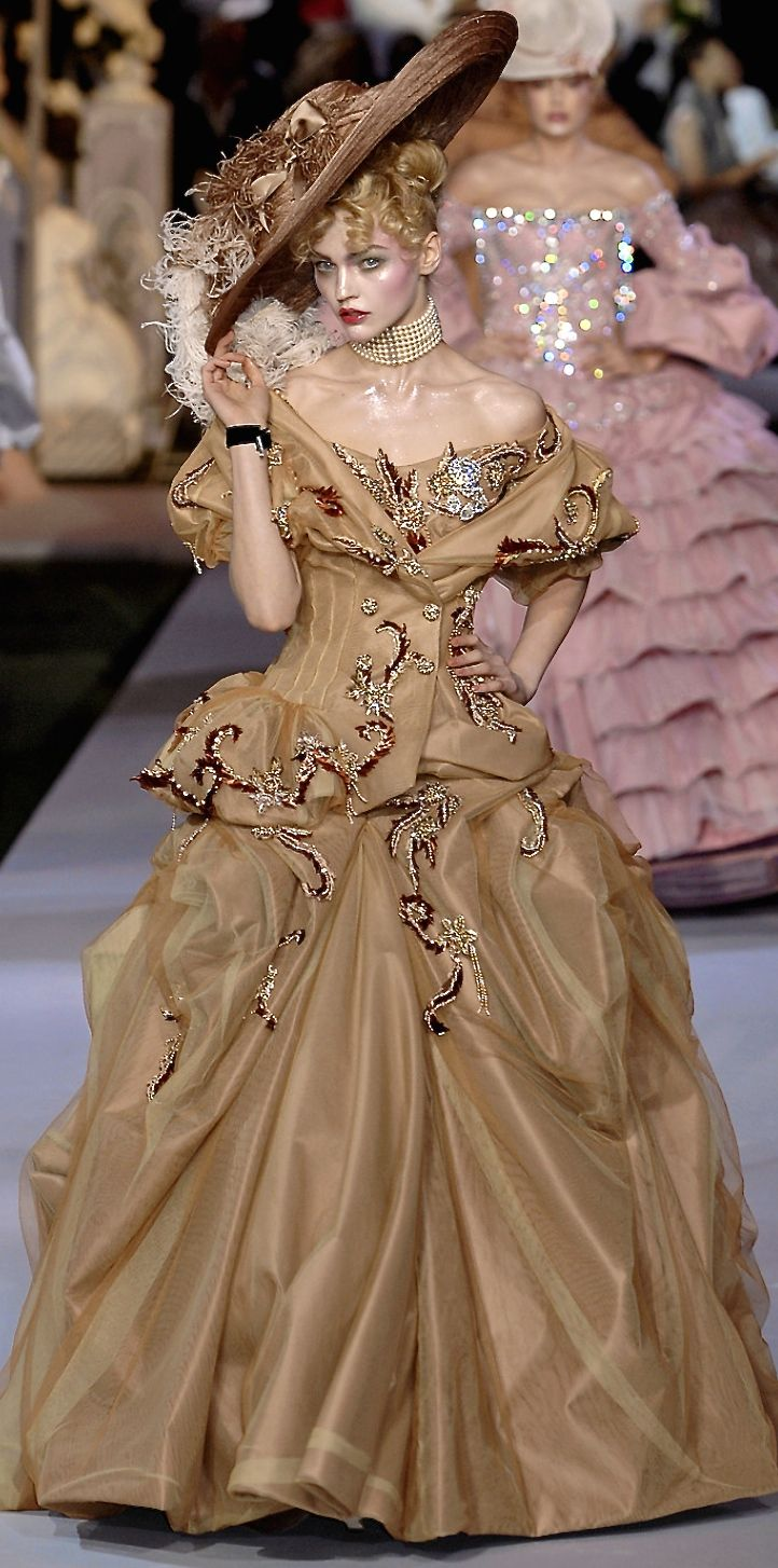 Christian Dior...Gorgeous, imagine this in bridal fabric. et that designer look without the designer $$$, have it custom-made.Recreate those details that would match your wedding theme. Be open for suggestions from your dressmaker.