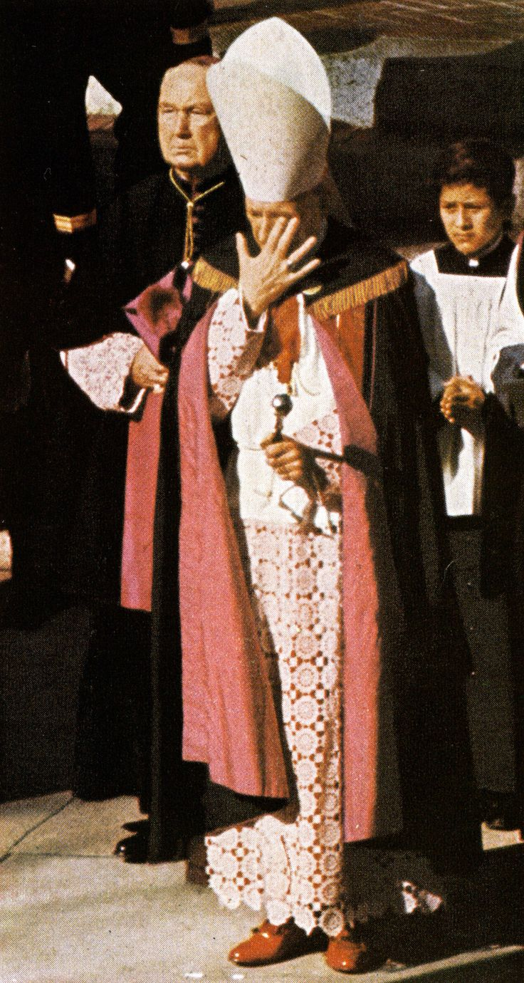 11/25/63: Cardinal Cushing brushes away tears, after the funeral service at St. Matthews Cathedral.