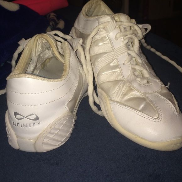Nfinity Cheer Shoes White Nfinity cheer/dance/poms shoes. Worn a couple of times before I quit. Still in almost perfect condition! Willing to trade & negociate pricing!❤️ nfinity Shoes Athletic Shoes