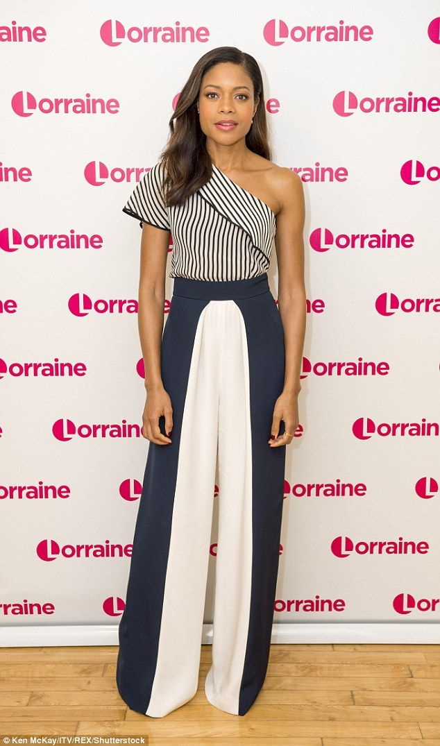 Earned her fashion stripes: Naomie looked phenomenal for her appearance on the ITV show, donning an one shoulder striped top and flared trousers