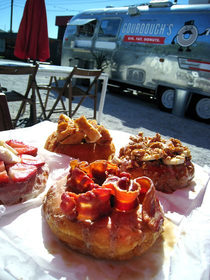 try bacon or fried chicken on a piping hot donut? Gourdough's in Austin is the place for gluttony. And son of the peach
