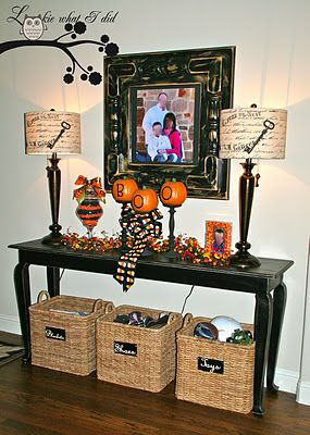 I'm pinning this because I like the entry table with the baskets underneath. Great for shoes. Table would be great to change every season.