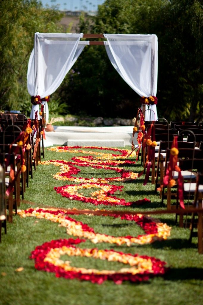 southern california wedding, middle eastern inspired wedding, sri lankin, outdoor wedding ceremony, wooden ceremony arch, floral ailse runner, red and gold wedding flowers