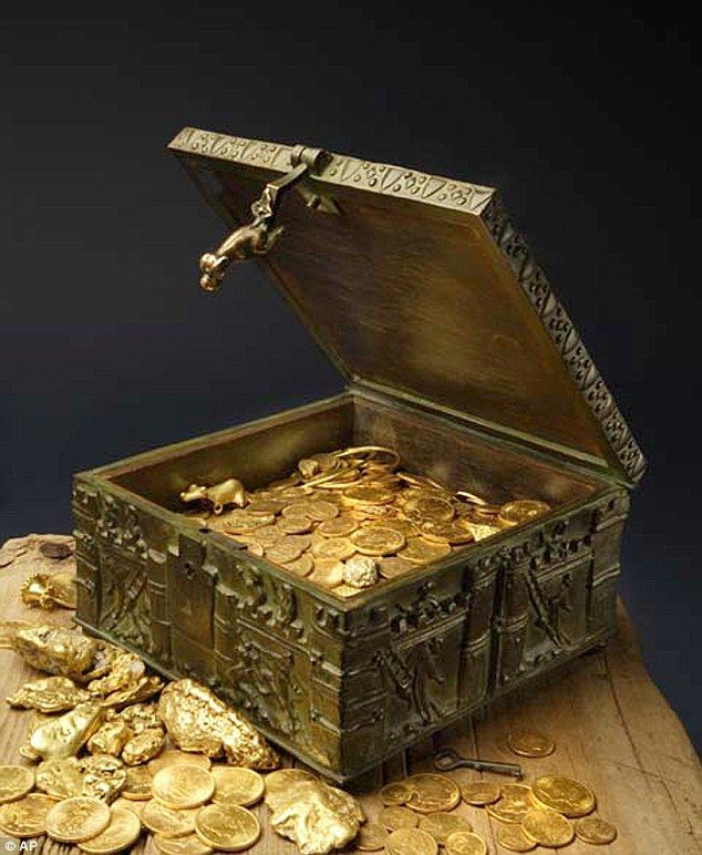 Storybook treasure: This undated photo provided by Forrest Fenn shows a chest purported to contain gold dust, hundreds of rare gold coins, gold nuggets and other artifacts - find a treasure thought lost or discover it before someone else. Use it to buy the machines, live comfortably and fund the families who choose to stay.