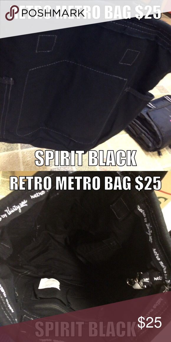 Thirty One Retro Metro Bag in Spirit Black, NOP Thirty One Retro Metro Bag in Spirit Black, New out of package. Pockets inside and two on side of bag. One lobster claw clip inside of bag to clip keys or id badge to for easy access. Makes a great gym bag! 31 Bags Totes