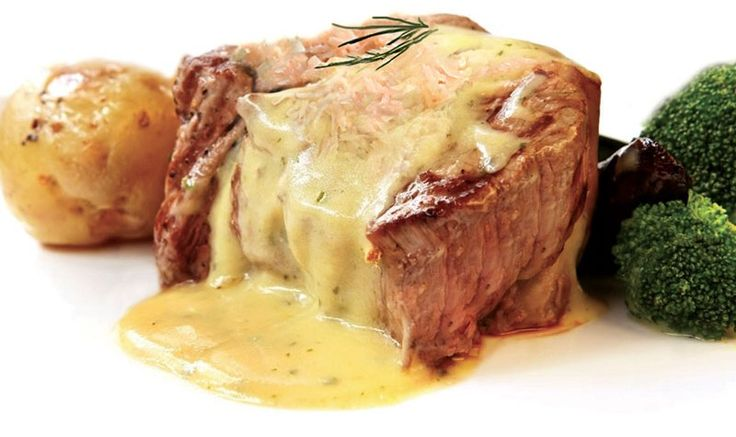 CRAB MEAT STEAK OSCAR  Try this recipe to really kick your steak dinner up a few notches.